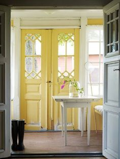 an absolute must in my future home. old doors painted bright yellow. so homey and cheerful