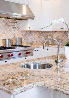 Thick granite slab in gorgeous sand, with matching backsplash