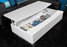 This stylish white gloss coffee table has a handy storage compartment within. The lid can also be locked into place to create a space to rest your laptop or dinner.