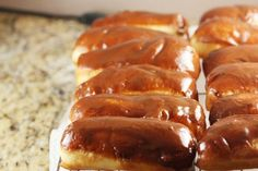Long John donuts filled with a homemade vanilla cream mixture and glazed in chocolate and maple glazes.