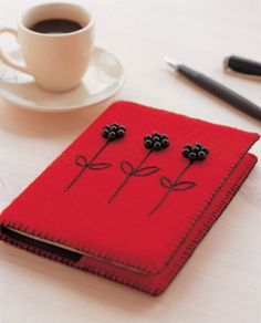 Book cover with beaded flower and embroidery stems