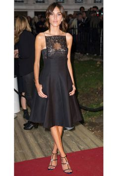 Alexa Chung wearing an elegant Dior black dress. Click here for more style inspiration.