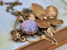 ENCHANTED FOREST,  antiqued brass Victorian style floral necklace with butterfly and vintage pink opal glass cab on Etsy, 10 394,74 Ft