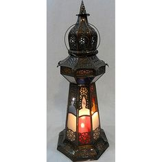 @Overstock - Moroccan lanterns are an excellent way to bring an exotic touch to an outdoor patio or front door entry to create a majestic entrance to your home. This 14th century-styled lamp will also beautifully light up any room in your home.http://www.overstock.com/Worldstock-Fair-Trade/Bronze-Stained-Glass-Princess-Lamp-Morocco/5679846/product.html?CID=214117 $69.99