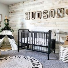 Good design is as easy as ABC. Love how the ABC rug looks in this rustic nursery. Design: @abakerlifeathome