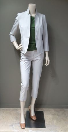 MaxMara light grey stretch cotton Capri pants suit | The jacket:  Modern fit with ¾ sleeve with top stitch finish. Collar can be worn turned down or as pictured | The pants: Stretch cotton, mid rise Capri pants | Weekend collection green cotton short-sleeve blouse | MaxMara nude leather sling back shoes with gold metallic block heel.  Prices on request.