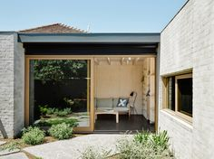 Architect-Rob-Kennon Northcote-House, a plywood and concrete addition to a house in a Melbourne suburb,-Brooke-Holm-photo | Remodelista