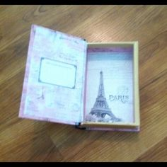 New Eiffel Tower Secret Book Jewelry Box Very cute Eiffel Tower box! Can be used for jewelry or stashing secret things! Got this as a gift but it's not really my style, never used!  Accessories