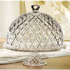 Domed crystal cake plate with beveled diamond detail. Product: Cake pedestal and domed lid Construction Material: Crystal Color: Clear Features: Embossed motif Perfect for bringing nostalgic appeal to your kitchen or dining roomDimensions: H x 11 Diameter Cake Plate With Dome, Cake Stand With Dome, Cupcake Stands, Crystal Cake Stand, Cupcake Boxes, Vintage Cake Stands, Cake Carrier, Pedestal Cake Stand, Glass Cakes