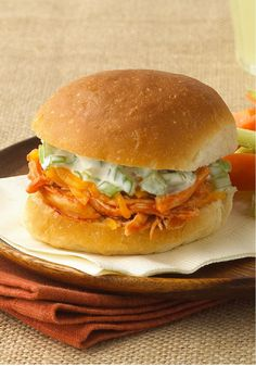 Buffalo Chicken Party Sandwiches -- Neatniks, rejoice! The crunch of celery, the heat of sauce and the cool of blue cheese in a bun with Buffalo chicken, minus the messy fingers you get with wings.