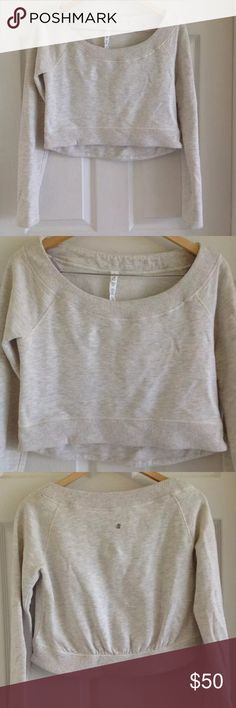 Lululemon Scoop Neck Crop Sweater Nearly new! This is adorable for pre-post work out or early morning yoga! Cropped so it's perfect to pair with high waisted lulu's. Size 4 fits size small. Heather oatmeal neutral color. lululemon athletica Sweaters Crew & Scoop Necks