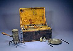 George Washington's personal camp chest,  1775-1776, England (made) used when commander of the Continental Army. Complete with all original utensils. Contains tin plates and platters, tin pots with detachable wooden handles, glass containers for condiments such as salt, pepper, and sugar, as well as knives and forks with dyed black ivory handles. The chest also contains a tinder box, candle stand, and folding gridiron. Smithsonian