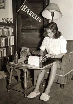 A student studies in her dorm room. Massachusetts, 1950's.