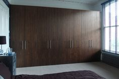 Fitted large wardrobe in walnut