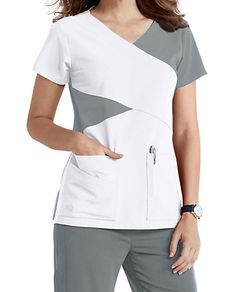 The Grey's Anatomy Signature mock wrap scrub top has detailed style lines and roomy pockets. Dental Uniforms, Work Uniforms, Dental Scrubs, Medical Scrubs, Scrubs Outfit, Scrubs Uniform, Stylish Scrubs, Cute Scrubs, Greys Anatomy Scrubs