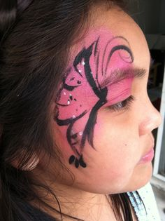 side butterfly face paint by A Looney Clown