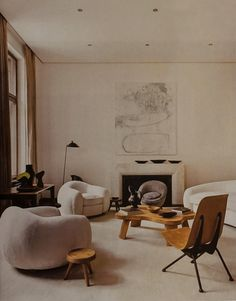 apartment of Emmanuel de Bayser in Berlin. Jean Royère L´Ours Polaire sofa group (1949), Jean Prouvé Antony chair (1954).