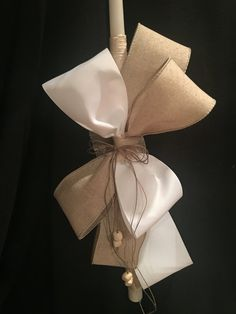 A very simple, elegant classy look candle. The neutral color with the white soft touch, added a cross with any color ribbon of your choice. it can be any color of your choice, pink for a girl, blue for a boy. Classy look. it can be used for baptism ceremony too. In Orthodox