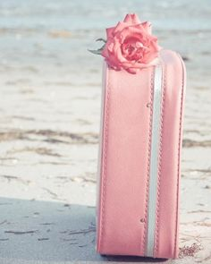 would be amazing to find a light pink suitcase to drape pearls out of as part of decor.. would have envelopes sitting on top with pens for guests to write their own addresses on to save the bride time in writing thank-yous !