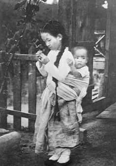 Pyongyang ca 1910-1930. A young girl cares for a boy.
