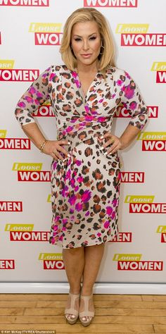 Flawless:  Anastacia looked beautiful in a colourful animal print wrap dress teamed with n...