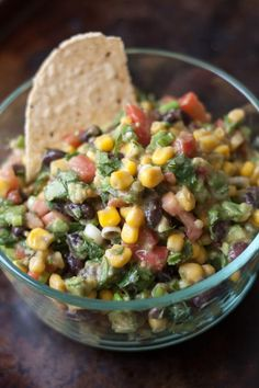 Ingredients  1- 15 oz can corn 1 can black beans 2 avocados (cubed) 2/3 cup chopped cilantro 8 green onion stalks, sliced 6 roma tomatoes Dressing:  1/4 cup olive oil 1/4 cup red wine vinegar 2 cloves minced garlic 3/4 teaspoon salt 1/8 teaspoon pepper 1 teaspoon cumin Mix first 6 ingredients together.  Combine dressing ingredients and pour over corn mixture.  Serve with tortilla chips..    I would probably sub frozen corn and lime juice for the vinegar