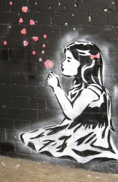 Describe the stencil: She is a girl  She is making a wish   It is a pink flower  She is black and white    How many layers do you think the stencil is?  What do you really like about the stencil?