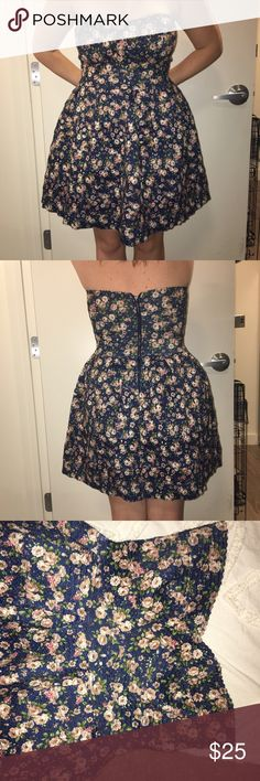 Blue Floral Fitted Bondage Skater Dress Beautiful Blue floral dress! It's that stretchy bondage type material so fits the breasts very well but elegantly flows outward. 70% polyester 30% latex.  Worn once. Sans Souci Dresses Strapless