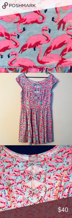 Flamingo dress Adorable and super comfortable flamingo-print dress. Cute bow cut out details on the front. Very flattering. Only worn once. eshakti Dresses