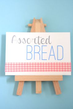 DIY Easel Food Labels - dollarama sells these mini easels with the tiny canvas included! What a cute idea!