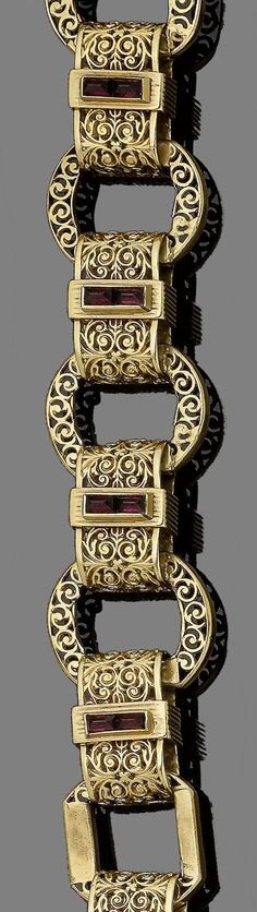 A late century gold and garnet fancy-link bracelet. Designed as a continuous row of pierced discs, connected by similarly engraved rectangular links of foliate design, centrally-set with two pyramidal-shaped garnets, French assay marks, lengths Garnet Jewelry, Enamel Jewelry, Gold Jewelry, Jewelry Box, Victorian Jewelry, Antique Jewelry, Vintage Jewelry, Link Bracelets, Jewelry Bracelets