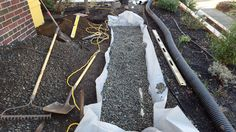 Short french drain to try & prevent a pond forming in the front yard when it rains hard.