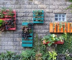 DIY Pallet Multicolored Painted Wall Art Planters  via http://diypallets.com
