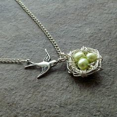 Bird nest necklace in silver with green by jinjajewellery on Etsy, £12.00