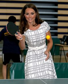 Catherine, Duchess of Cambridge plays table tennis as she visits Bacon's College on July 26, 2012 in London, England. Prince Harry, Prince William, Duke of Cambridge and Catherine, Duchess of Cambridge visited Bacon's College and launched the 'Coach Core' Programme, a partnership between their Foundation and Greenhouse.