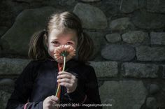 imagesbymarshelle, Young girl delighted with flower - Stock Photos & Images | Stockafe.com #stockafe #stockphotos #childphotography