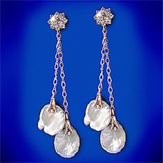 Tacori White Keshi Pearl and White Topaz Earrings    Tacori and Bridal Evening Line  The items are beautiful and intricate. Each piece is made of all natural resources, sterling silver, pearls and swarovski crystals.    Your Price $95.00