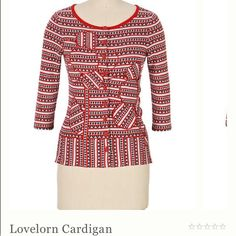 Super cute Anthropologie cardigan! The lovelorn cardigan by Moth from Anthropologie. It's 3/4 sleeves with a cute stripe, polka dot, and heart pattern and appliqué daisies of the same material. It's red, cream, and gray. It has buttons all the way down the front. 100% cotton, but feels like it has some stretch to it.   From website: Rows of hearts and dots race to and fro on Moth's intarsia cover-up, playing a game of loves-me, loves-me-not with a pair of appliqued daisies.  3/4 sleeves…