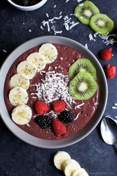 BANANA BERRY SMOOTHIE BOWL an easy delicious way to add protein, fiber, fruits, and veggies to your breakfast! Easily customize the toppings to your Smoothie Bowl. Tastes so good, you won't know it's healthy! Ahhhh ... deep sigh of relief! I cannot even describe to you how excited I am to get out of the holiday season recipes filled with comfort foods and desserts. Back to my normal routine of healthy family meals, post work out snacks, and breakfast recipes. Whew! For whatever reason...