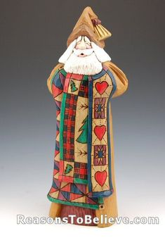 Triple quilt Santa carving by Dave Francis. One of Dave's all-time best Santa carvings with incredible design, detail and great use of rich colors. This wood Santa Claus has been completely hand carved, hand painted, wood-burned and signed by Dave Francis.