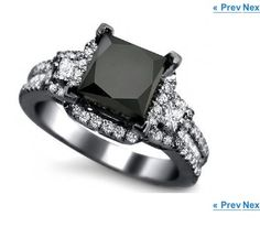 Black diamond engagement ring. Same quality half the price. It's unique! I want it! Everyone's rings look the same now a days.