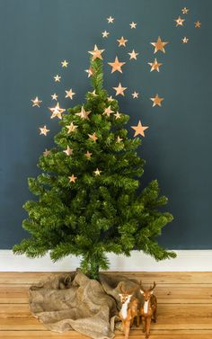 Oooooh how magical is this tree/wall decor? Not only is this copper star  tree decor whimsical, it also cuts down on all that work of decorating the  lower ...