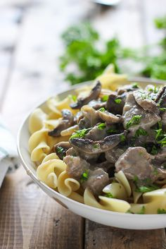 A basic recipe for beef stroganoff with thick strips of steak and mushrooms smothered in a creamy, sour cream sauce.