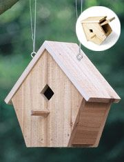 Simple wooden birdhouse made from one board