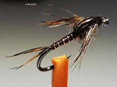 No automatic alt text available. Trout Fishing, Fishing Lures, Fly Tying Patterns, Gone Fishing, Some Fun, Plant Hanger, Wallpaper, Feathers, River