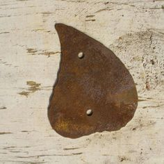 """""""LEAF"""" Cute Leaf Shape These cute rusted shapes are made for attaching to any wall, post, fence or sign.  Made from thick 16 ga (thick as a nickel) metal these are not imported cheap tin shapes.  Your shape will include mounting screws 1/2″ long to attach the shape. Buy with confidence this will look good."""