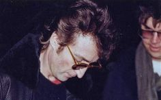 John Lennon signs an autograph for Mark Chapman – his murderer (December 8, 1980).   Source: 25 Rare Pictures That Have Historical Values. I Honestly Have No Words For This. - GoAmok.com