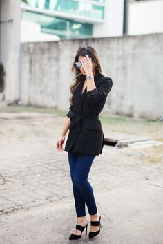 Pam Hetlinger, The Girl From Panama wearing a Zara Belted Blazer, Joe's Jeans, whistles pointed toe slide mules, and Dior Abstract Sunglasses.
