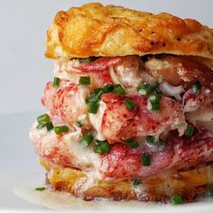 Homemade Triple Stacked Lobster Cheddar Cheese Biscuit Burger dripping in butter