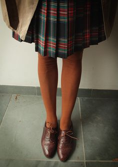Brown stockings, brown lace ups, tartan skirt. Vintage inspired winter outfit.